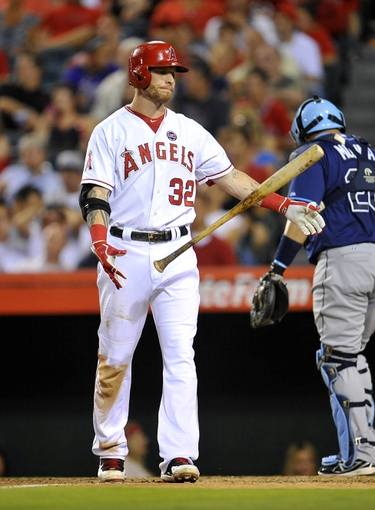 September 4, 2013; Anaheim, CA, USA; Los Angeles Angels right fielder Josh Hamilton (32) reacts after striking out to end the third inning against the Tampa Bay Rays at Angel Stadium of Anaheim. Mandatory Credit: Gary A. Vasquez-USA TODAY Sports