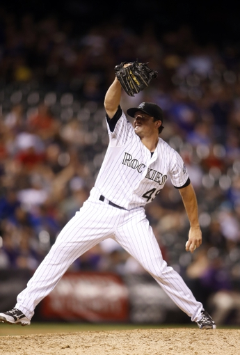 Sep 4, 2013; Denver, CO, USA; Colorado Rockies pitcher Rex Brothers (49) delivers a pitch during the ninth inning against the Los Angeles Dodgers at Coors Field. The Rockies won 7-5.  Mandatory Credit: Chris Humphreys-USA TODAY Sports