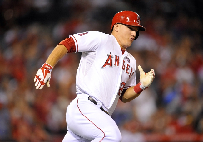 September 4, 2013; Anaheim, CA, USA; Los Angeles Angels center fielder Mike Trout (27) runs after hitting a double in the sixth inning against the Tampa Bay Rays at Angel Stadium of Anaheim. Mandatory Credit: Gary A. Vasquez-USA TODAY Sports
