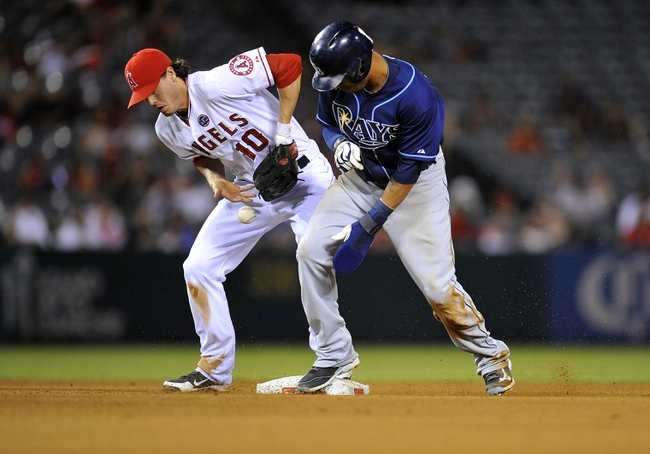 September 4, 2013; Anaheim, CA, USA; Tampa Bay Rays center fielder Desmond Jennings (8) is safe at second as Los Angeles Angels second baseman Grant Green (10) loses control of the ball in the seventh inning at Angel Stadium of Anaheim. Mandatory Credit: Gary A. Vasquez-USA TODAY Sports