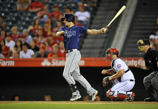 September 4, 2013; Anaheim, CA, USA; Tampa Bay Rays right fielder Wil Myers (9) hits a single in the ninth inning against the Los Angeles Angels at Angel Stadium of Anaheim. Mandatory Credit: Gary A. Vasquez-USA TODAY Sports