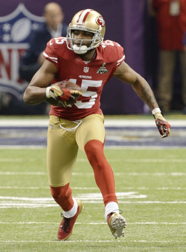 Feb 3, 2013; New Orleans, LA, USA;  San Francisco 49ers wide receiver Michael Crabtree (15) runs for yards after the catch first quarter in Super Bowl XLVII at the Mercedes-Benz Superdome. Mandatory Credit: Jack Gruber-USA TODAY Sports