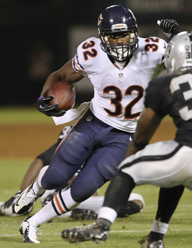 Aug 23, 2013; Oakland, CA, USA; Chicago Bears running back Michael Ford (32) carries the ball for a touchdown  during the fourth quarter at O.co Coliseum. The Chicago Bears defeated the Oakland Raiders 34-26. Mandatory Credit: Kelley L Cox-USA TODAY Sports