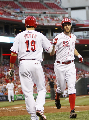 Sep 5, 2013; Cincinnati, OH, USA; Cincinnati Reds starting pitcher Tony Cingrani (52) is congratulated by first baseman Joey Votto (19) after scoring during the second inning against the St. Louis Cardinals at Great American Ball Park. Mandatory Credit: Frank Victores-USA TODAY Sports