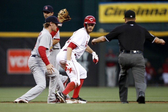 Sep 5, 2013; Cincinnati, OH, USA; Cincinnati Reds starting pitcher Tony Cingrani (52) steals second base during the second inning against the St. Louis Cardinals shortstop Ryan Jackson (8) at Great American Ball Park. Mandatory Credit: Frank Victores-USA TODAY Sports