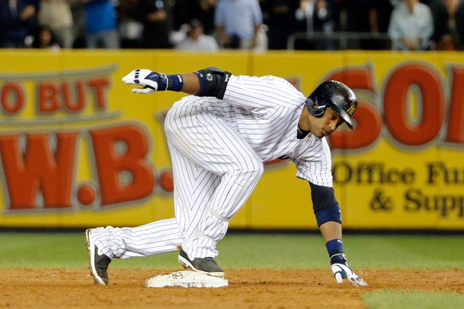Sep 5, 2013; Bronx, NY, USA;   New York Yankees second baseman Robinson Cano (24) slides to second on his two run double during the third inning against the Boston Red Sox at Yankee Stadium. Mandatory Credit: Anthony Gruppuso-USA TODAY Sports