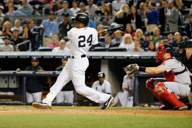 Sep 5, 2013; Bronx, NY, USA;   New York Yankees second baseman Robinson Cano (24) doubles to deep right allowing two runners to score during the third inning against the Boston Red Sox at Yankee Stadium. Mandatory Credit: Anthony Gruppuso-USA TODAY Sports