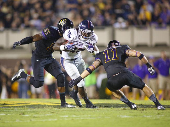 September 5, 2013; Greenville, NC, USA;  Florida Atlantic running back Jonathan Wallace (27) carries the ball past the East Carolina defensive back Damon Maqazu (11) during the 2nd quarter at Bagwell Field at Dowdy-Ficklen Stadium. Mandatory Credit: James Guillory-USA TODAY Sports