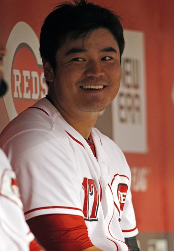 Sep 5, 2013; Cincinnati, OH, USA; Cincinnati Reds center fielder Shin-Soo Choo (17) sits in the dug out after hitting a solo home run during the fourth inning against the St. Louis Cardinals at Great American Ball Park. Mandatory Credit: Frank Victores-USA TODAY Sports