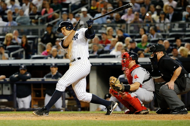 Sep 5, 2013; Bronx, NY, USA;  New York Yankees third baseman Alex Rodriguez (13) doubles to deep left during the sixth inning against the Boston Red Sox at Yankee Stadium. Mandatory Credit: Anthony Gruppuso-USA TODAY Sports