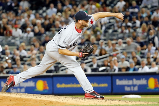 Sep 5, 2013; Bronx, NY, USA;   Boston Red Sox relief pitcher Matt Thornton (38) delivers a pitch during the seventh inning against the New York Yankees at Yankee Stadium. Mandatory Credit: Anthony Gruppuso-USA TODAY Sports