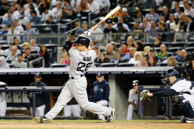 Sep 5, 2013; Bronx, NY, USA;  Boston Red Sox left fielder Daniel Nava (29) doubles to deep right center during the seventh inning against the New York Yankees at Yankee Stadium. Mandatory Credit: Anthony Gruppuso-USA TODAY Sports