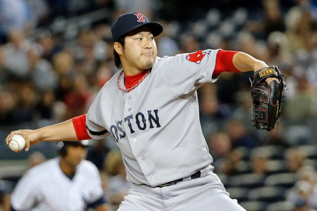 Sep 5, 2013; Bronx, NY, USA;  Boston Red Sox relief pitcher Junichi Tazawa (36) pitches during the seventh inning against the New York Yankees at Yankee Stadium. Mandatory Credit: Anthony Gruppuso-USA TODAY Sports