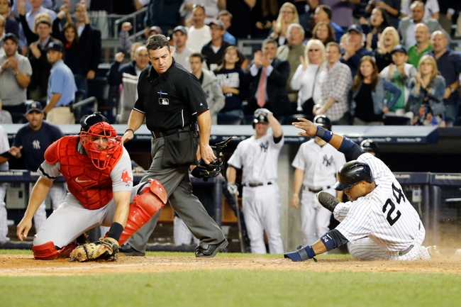 Sep 5, 2013; Bronx, NY, USA;  New York Yankees second baseman Robinson Cano (24) slides home to score as Boston Red Sox catcher Ryan Lavarnway (20) waits for the ball during the seventh inning at Yankee Stadium. Mandatory Credit: Anthony Gruppuso-USA TODAY Sports