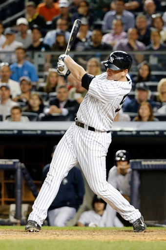 Sep 5, 2013; Bronx, NY, USA;  New York Yankees first baseman Lyle Overbay (55) singles to right allowing two runners to score during the seventh inning against the Boston Red Sox at Yankee Stadium. Mandatory Credit: Anthony Gruppuso-USA TODAY Sports