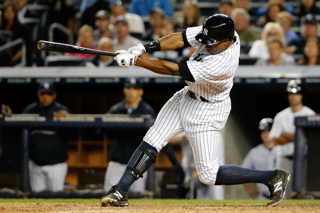 Sep 5, 2013; Bronx, NY, USA;  New York Yankees right fielder Curtis Granderson (14) doubles to deep right allowing a runner to score during the seventh inning against the Boston Red Sox at Yankee Stadium. Mandatory Credit: Anthony Gruppuso-USA TODAY Sports