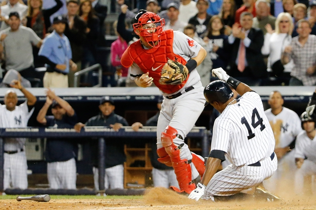 Sep 5, 2013; Bronx, NY, USA;  New York Yankees right fielder Curtis Granderson (14) slides home to score as the ball is overthrown to Boston Red Sox catcher Ryan Lavarnway (20) during the seventh inning at Yankee Stadium. Mandatory Credit: Anthony Gruppuso-USA TODAY Sports