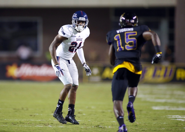 September 5, 2013; Greenville, NC, USA;  Florida Atlantic defensive back D'Joun Smith (21) looks up in defensive coverage against East Carolina at Dowdy-Ficklen Stadium. East Carolina Pirates defeated the Florida Atlantic Owls 31-13. Mandatory Credit: James Guillory-USA TODAY Sports