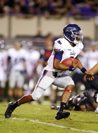 September 5, 2013; Greenville, NC, USA;  Florida Atlantic quarterback Greg Hankerson (6) runs with the ball against East Carolina at Dowdy-Ficklen Stadium. East Carolina Pirates defeated the Florida Atlantic Owls 31-13. Mandatory Credit: James Guillory-USA TODAY Sports