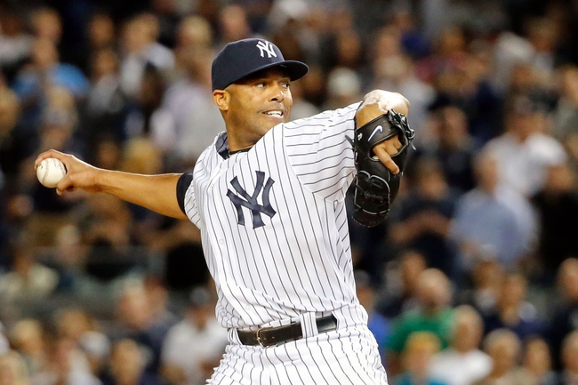 Sep 5, 2013; Bronx, NY, USA;   New York Yankees relief pitcher Mariano Rivera (42) pitches during the ninth inning against the Boston Red Sox at Yankee Stadium. Boston won 9-8 in ten innings.  Mandatory Credit: Anthony Gruppuso-USA TODAY Sports