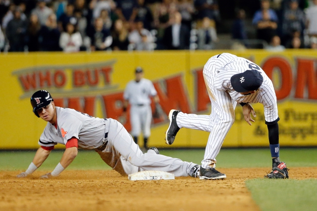 Sep 5, 2013; Bronx, NY, USA;   Boston Red Sox left fielder Quintin Berry (50) steals second during the ninth inning against the New York Yankees at Yankee Stadium. Boston won 9-8 in ten innings.  Mandatory Credit: Anthony Gruppuso-USA TODAY Sports