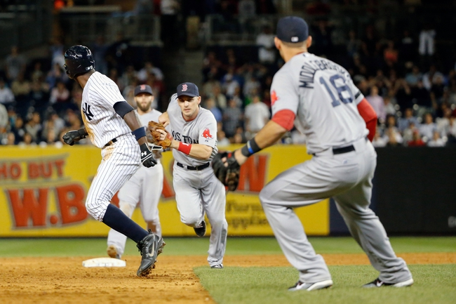Sep 5, 2013; Bronx, NY, USA;  New York Yankees left fielder Alfonso Soriano (12) is caught stealing third by Boston Red Sox shortstop Stephen Drew (7) during the ninth inning at Yankee Stadium. Boston won 9-8 in ten innings.  Mandatory Credit: Anthony Gruppuso-USA TODAY Sports