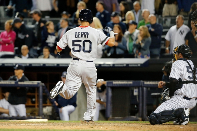 Sep 5, 2013; Bronx, NY, USA;  Boston Red Sox left fielder Quintin Berry (50) crosses the plate to score during the ninth inning against the New York Yankees at Yankee Stadium. Boston won 9-8 in ten innings.  Mandatory Credit: Anthony Gruppuso-USA TODAY Sports