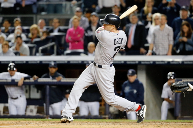 Sep 5, 2013; Bronx, NY, USA;  Boston Red Sox shortstop Stephen Drew (7) singles allowing a runner to score during the ninth inning against the New York Yankees at Yankee Stadium. Boston won 9-8 in ten innings.  Mandatory Credit: Anthony Gruppuso-USA TODAY Sports