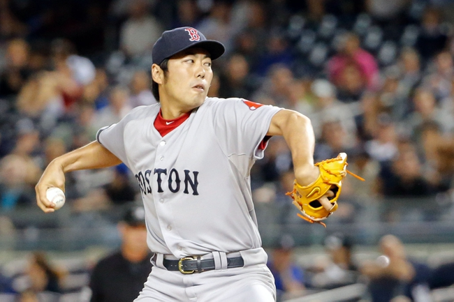 Sep 5, 2013; Bronx, NY, USA;  Boston Red Sox relief pitcher Koji Uehara (19) pitches during the tenth inning against the New York Yankees at Yankee Stadium. Boston won 9-8 in ten innings.  Mandatory Credit: Anthony Gruppuso-USA TODAY Sports