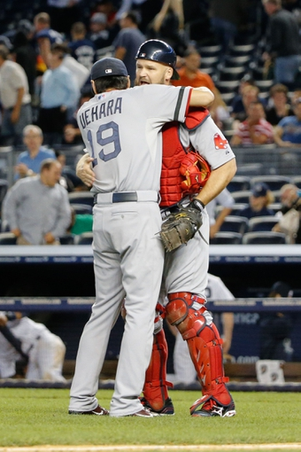 Sep 5, 2013; Bronx, NY, USA;  Boston Red Sox relief pitcher Koji Uehara (19) and catcher David Ross (3) celebrate the win against the New York Yankees at Yankee Stadium. Boston won 9-8 in ten innings.  Mandatory Credit: Anthony Gruppuso-USA TODAY Sports