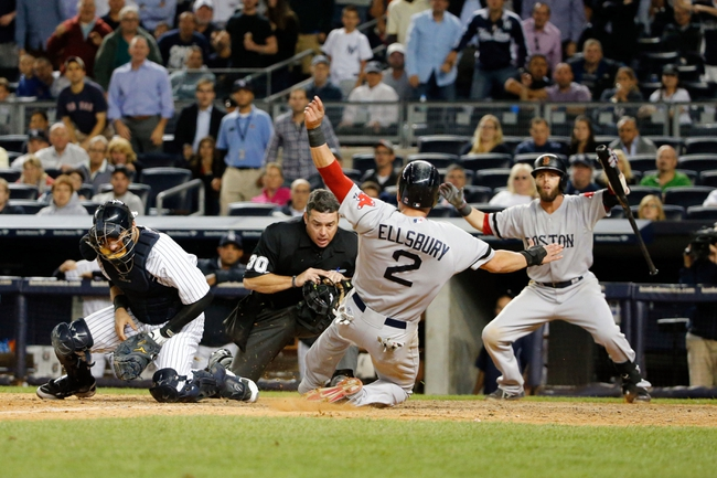 Sep 5, 2013; Bronx, NY, USA;   Boston Red Sox center fielder Jacoby Ellsbury (2) slides home to score during the tenth inning against the New York Yankees at Yankee Stadium. Boston won 9-8 in ten innings.  Mandatory Credit: Anthony Gruppuso-USA TODAY Sports
