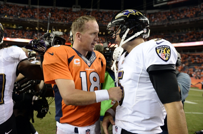 Sep 5, 2013; Denver, CO, USA;  Denver Broncos quarterback Peyton Manning (18) greats Baltimore Ravens quarterback Joe Flacco (5) following the end of the game at Sports Authority Field at Mile High. The Broncos defeated the Ravens 49-27. Mandatory Credit: Ron Chenoy-USA TODAY Sports
