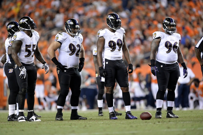 Sep 5, 2013; Denver, CO, USA;  Baltimore Ravens outside linebacker Terrell Suggs (55) and defensive tackle Haloti Ngata (92) and  defensive tackle Chris Canty (99) and defensive end Marcus Spears (96) during the game against the Denver Broncos at Sports Authority Field at Mile High. The Broncos defeated the Ravens 49-27. Mandatory Credit: Ron Chenoy-USA TODAY Sports