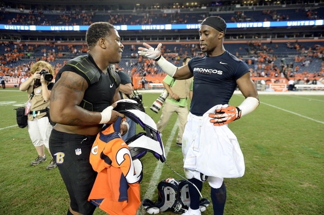 Sep 5, 2013; Denver, CO, USA; Denver Broncos free safety Rahim Moore (right) exchanges his jersey with Baltimore Ravens running back Ray Rice (27) following the game at Sports Authority Field at Mile High. The Broncos defeated the Ravens 49-27. Mandatory Credit: Ron Chenoy-USA TODAY Sports