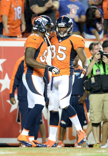 Sep 5, 2013; Denver, CO, USA; Denver Broncos wide receiver Demaryius Thomas (88) is congratulated for his touchdown reception by tight end Virgil Green (85) during the game against the Baltimore Ravens at Sports Authority Field at Mile High. The Broncos defeated the Ravens 49-27. Mandatory Credit: Ron Chenoy-USA TODAY Sports