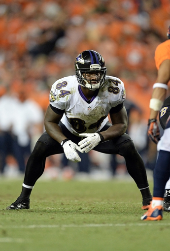 Sep 5, 2013; Denver, CO, USA;  Baltimore Ravens tight end Ed Dickson (84) at the line of scrimmage in the fourth quarter against the Denver Broncos at Sports Authority Field at Mile High. The Broncos defeated the Ravens 49-27. Mandatory Credit: Ron Chenoy-USA TODAY Sports