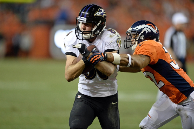 Sep 5, 2013; Denver, CO, USA; Baltimore Ravens wide receiver Brandon Stokley (80) is defended after a reception by Denver Broncos defensive back Tony Carter (32) in the fourth quarter at Sports Authority Field at Mile High. The Broncos defeated the Ravens 49-27. Mandatory Credit: Ron Chenoy-USA TODAY Sports
