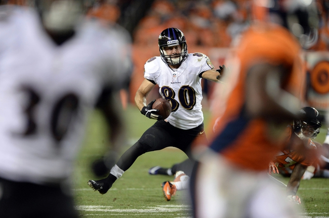 Sep 5, 2013; Denver, CO, USA; Baltimore Ravens wide receiver Brandon Stokley (80) runs after a reception in the fourth quarter against the Denver Broncos at Sports Authority Field at Mile High. The Broncos defeated the Ravens 49-27. Mandatory Credit: Ron Chenoy-USA TODAY Sports