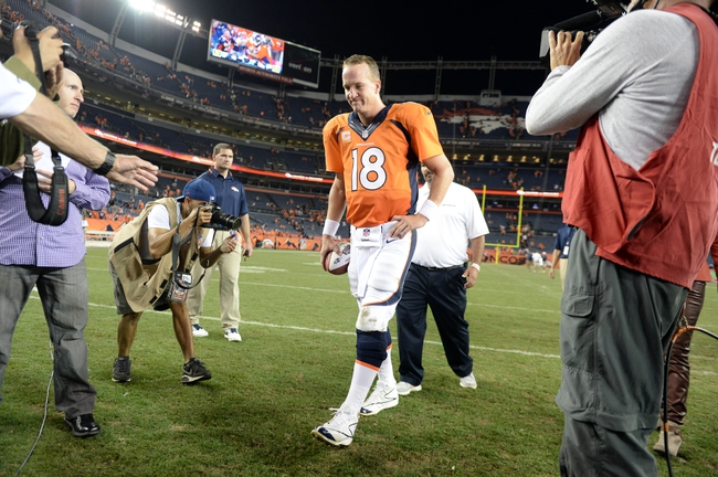 Sep 5, 2013; Denver, CO, USA; Denver Broncos quarterback Peyton Manning (18) reacts as he leaves the field following the win over the Baltimore Ravens at Sports Authority Field at Mile High. The Broncos defeated the Ravens 49-27. Mandatory Credit: Ron Chenoy-USA TODAY Sports