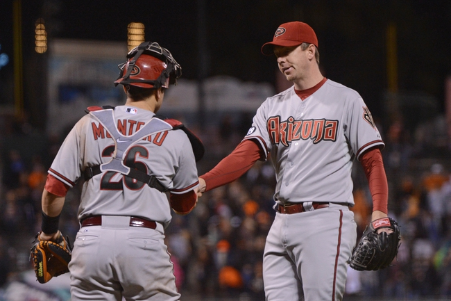 September 5, 2013; San Francisco, CA, USA; Arizona Diamondbacks relief pitcher Brad Ziegler (29, right) is congratulated by catcher Miguel Montero (26, left) after the game against the San Francisco Giants at AT&T Park. The Diamondbacks defeated the Giants 4-2. Mandatory Credit: Kyle Terada-USA TODAY Sports