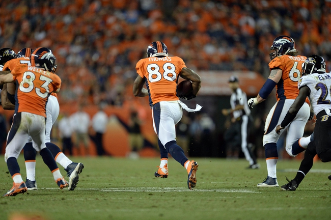 Sep 5, 2013; Denver, CO, USA; Denver Broncos wide receiver Demaryius Thomas (88) runs for a touchdown during the fourth quarter against the Baltimore Ravens at Sports Authority Field at Mile High. The Broncos defeated the Ravens 49-27. Mandatory Credit: Ron Chenoy-USA TODAY Sports