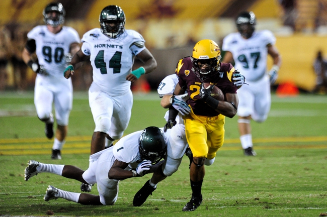 Sep 5, 2013; Tempe, AZ, USA;  Arizona State Sun Devils running back Deantre Lewis (25) is tackled by Sacramento State Hornets defensive back Osagie Odiase (1) after a 57 yards run during the second half at Sun Devil Stadium. Mandatory Credit: Matt Kartozian-USA TODAY Sports