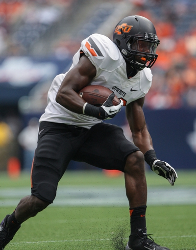 Aug 31, 2013; Houston, TX, USA; Oklahoma State Cowboys running back Desmond Roland (26) runs with the ball during the third quarter against the Mississippi State Bulldogs at Reliant Stadium. Mandatory Credit: Troy Taormina-USA TODAY Sports