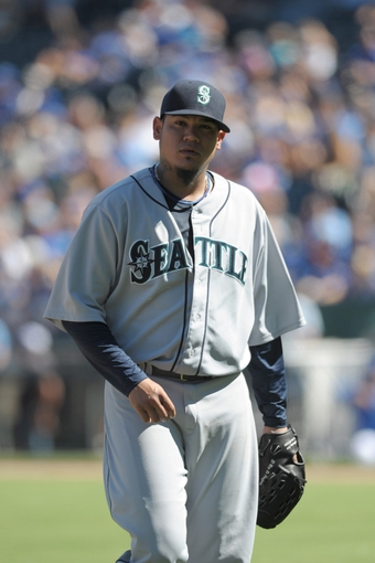 Sep 2, 2013; Kansas City, MO, USA; Seattle Mariners starting pitcher Felix Hernandez (34) walks to the dugout in between innings of the game against the Kansas City Royals at Kauffman Stadium. The Royals won 3-1. Mandatory Credit: Denny Medley-USA TODAY Sports