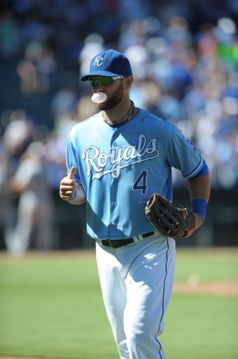 Sep 2, 2013; Kansas City, MO, USA; Kansas City Royals left fielder Alex Gordon (4) walks to the dugout in between innings of the game against the Seattle Mariners at Kauffman Stadium. The Royals won 3-1. Mandatory Credit: Denny Medley-USA TODAY Sports