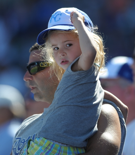 Sep 2, 2013; Kansas City, MO, USA; A young Kansas City Royals watches play late in the game against the Seattle Mariners at Kauffman Stadium. The Royals won 3-1. Mandatory Credit: Denny Medley-USA TODAY Sports