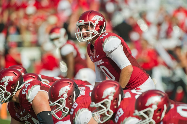 Aug 31, 2013; Fayetteville, AR, USA; Arkansas Razorback quarterback Brandon Allen (10) calls a play during a game against the Louisiana Ragin' Cajuns at Donald W. Reynolds Razorback Stadium. Arkansas defeated Louisiana 34-14. Mandatory Credit: Beth Hall-USA TODAY Sports