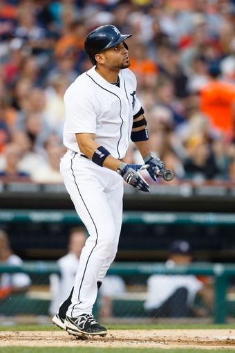 Aug 30, 2013; Detroit, MI, USA; Detroit Tigers second baseman Omar Infante (4) at bat against the Cleveland Indians at Comerica Park. Mandatory Credit: Rick Osentoski-USA TODAY Sports