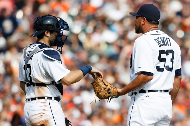 Sep 1, 2013; Detroit, MI, USA; Detroit Tigers catcher Alex Avila (13) gives the ball to relief pitcher Joaquin Benoit (53) against the Cleveland Indians at Comerica Park. Mandatory Credit: Rick Osentoski-USA TODAY Sports