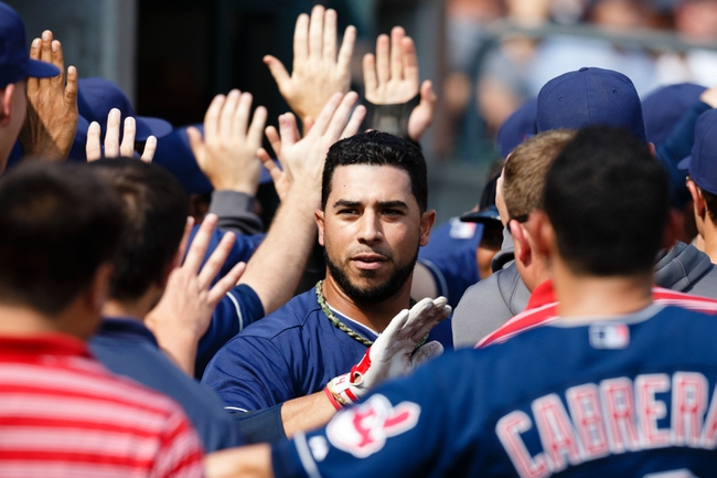 Sep 1, 2013; Detroit, MI, USA; Cleveland Indians third baseman Mike Aviles (4) is congratulated by teammates after he hit a grand slam home run during the ninth inning against the Detroit Tigers at Comerica Park. Mandatory Credit: Rick Osentoski-USA TODAY Sports